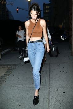 The model is no stranger to repeat looks and these high-waisted mom jeans are definitely on her list of favorite pieces. Jenner has been spotted in her $70 Topshop denim three times this summer. - HarpersBAZAAR.com