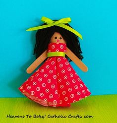 This is Edwina, one of the characters in the skit ANGELS IN OUR MIDST, a skit about St. Damien and St. Marianne Cope. She is quickly made from a plastic spoon. Her dress is made form a circle which is folded twice. A very fun craft for children to make. The skit is found on this board. HEAVENS TO BETSY! CATHOLIC CRAFTS. COM
