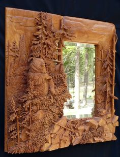 Beautifully detailed, carved wood mirror.