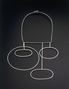 """Betty Cooke's jewelry reflects the abstract, organic shapes associated with mid twentieth-century modernism. As in this neckpiece, Cooke prefers curvilinear shapes, which demonstrate action and warmth, as opposed to straight lines. Her jewelry typified the Good Design movement, of pure, non-decorative designs. Her philosophy, """"Jewelry should be integrated easily and simply with fashion"""". Neckpiece via Museum of Art and Design."""