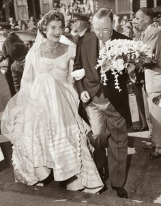 bev61:  This picture is so cute. Hugh carrying Jackie's bouquet.