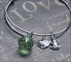 A personal favorite from my Etsy shop https://www.etsy.com/listing/250828397/silver-bangle-bracelet-frog-charm