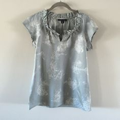 Banana Republic Cotton and Silk Top Gray and white print top with ruffled neckline. 52% cotton/48% silk. Very cute. Excellent condition - worn once or twice. Banana Republic Tops Blouses