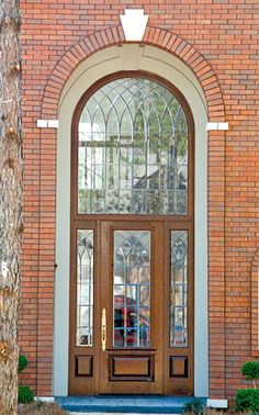 """Door Style DbyD-1046.  This Mahogany Front Exterior Entry shows a single Style """"C-2"""" Door with matching Style """"C-2"""" Sidelites and an Extended Leg Radius Transom.  The Glass was designed and built by Doors by Decora."""