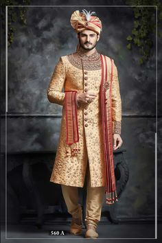 A designer Orange Sherwani made of Silk fabric. This slit cut style Sherwani enhanced with heavy embroidery all over to gives a royal look. It has well placed decorative buttons and full sleeves for the best look. Indian Wedding Poses, Wedding Dresses Men Indian, Groom Wedding Dress, Indian Wedding Couple Photography, Bengali Wedding, Indian Bridal, Sherwani For Men Wedding, Sherwani Groom, Wedding Men