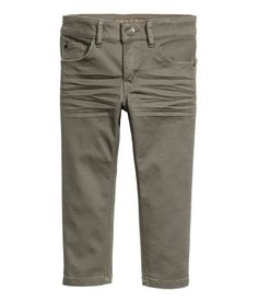 Khaki green. 5-pocket, slim-fit pants in stretch cotton twill with an adjustable elasticized waistband and zip fly with button.