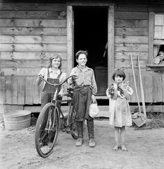 August 1939, Thurston County, Michigan Hill, Washington. Three of the four Arnold children. The oldest boy earned the money to buy his bicycle. Dorothea Lange LC-DIG-fsa-8b34759 www.loc.gov #American #History #Washington  Despite the original title, the 4th child appears to be in the window.