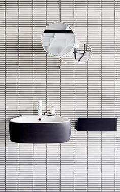 floating sink by Agape + white tile + black grout + round mirror Bathroom Toilets, Laundry In Bathroom, Mirror Bathroom, Washroom, Bathroom Interior, Modern Bathroom, Quirky Bathroom, White Bathrooms, White Tiles Black Grout