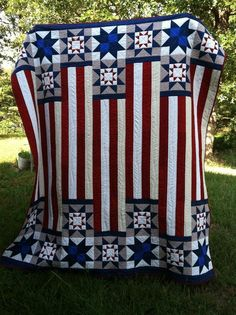 "I didn't make this quilt, but I am definitely inspired by it. It was a ""Quilts of Valor"" project by a very patriotic quilter. ""Quilts of Valor"" distributes homemade quilts to wounded soldiers back from war. Blue Quilts, Star Quilts, Quilt Blocks, Navy Quilt, Star Blocks, Quilt Kits, Mini Quilts, Patchwork Quilting, Quilting Projects"
