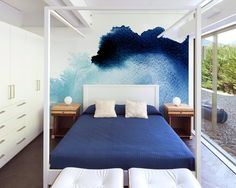 Watercolors are trending and we can see why! This room looks lovely with this stunning blue watercolor mural!