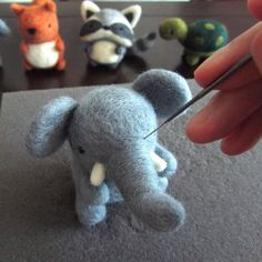 Day 10 of #WeBeTEST is #Making. This pic is from a while ago when I was smoothing out fuzzies on an elephant I made.#torontoetsystreetteam #process #needlefelting #felting #fibreart #torontomakers #torontoartists #makersgonnamake #handsandhustle #madebymyhands #meetthemaker by wildwhimsywoolies