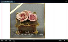 Porcelain roses over a jewellery box
