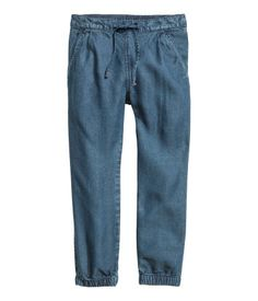 $7.99 Denim blue. CONSCIOUS. Joggers in soft, washed denim made from Tencel® lyocell. Elasticized drawstring waistband with pleats, side pockets, and elasticized