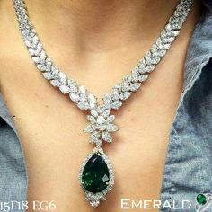 Look Classy by adorning emerald necklace.