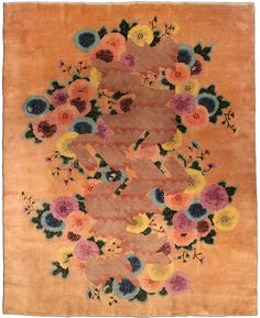 A second quarter 20th century Chinese Deco rug, with a cinnamon field that is dominated by an enormous polychrome blossom bunch with unusual alternating diagonal vinery bands. Watch full size video of A Chinese Deco rug, Circa 1940, ID BB4281 - Video