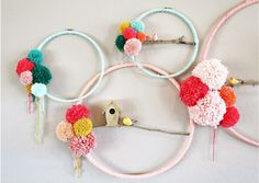 Are you in love with crafting with embroidery hoops in different ways like I am? Here is a beautiful way to upcycle them by wrapping the hoops, placing sticks inside and embellishing them with pomp…