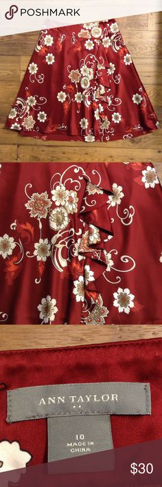 """Ann Taylor red floral skirt size 10 Ruffle detail down from. All over floral print. Lined. 100% polyester but feels like silky and smooth. One tiny pull in the front, but otherwise excellent condition. Side zipper. Approximately 16"""" across at the waist. Ann Taylor Skirts A-Line or Full"""