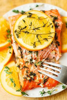 Orange Rosemary-Thyme Salmon is sweet, spicy and makes the perfect dinner for family!