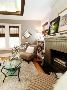 Painted brick on the fireplace and gray walls.