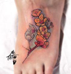 flowers tattoo on feet by alletattoo shop