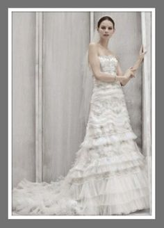 This was my wedding dress!!! It is an Oleg Cassini Wedding Dress. Cost when I purchased was $1200. I love this dress!!!