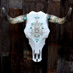 Victorian Turquoise Cow Skull. This lady makes some really cool stuff. I want to make my own, cause who has 680 bucks for this? otherwise these are radical!  http://www.childofwild.com/collections/bones/products/victorian-turquoise-cow-skull