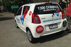 Vehicle Warping designed, printed and installed by Sign A Rama Box Hill for Domino's pizza delivery car.