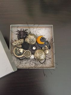 A Holloween brooch of sliver buttons clustered with Holloween symbols by OnTheButtonPath on Etsy
