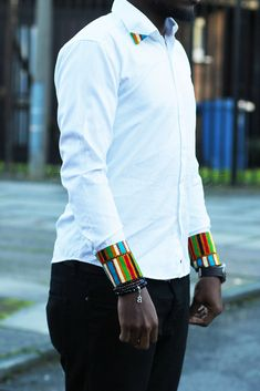 This is an interesting African twist on a plain white oxford shirt African Attire For Men, African Clothing For Men, African Print Fashion, African Wear, African Dress, African Fabric, African Tops, African Shirts, African Women