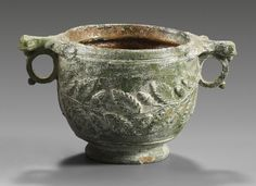 Roman terracotta skyphos with green lead glaze and plastic decor in form of oakleaves and acorns 1st century B.C.-1st century A.D. 8.9 cm high. Private collection