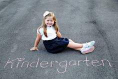 First day of school pictures with sidewalk chalk... Will have to remember this idea