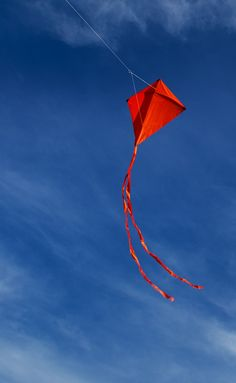 "A diamond kite with streamer tails - all in blood red. But it works well - hot color against the cool blue sky! T.P. (my-best-kite.com) ""flight"" Photo by ** RCB ** on Flickr (cc)"