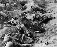 Fallen members of a mixed Hitlerjugend/Volkssturm unit in their trenches. Seelow Heights/Germany, April 1945.