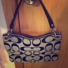 Coach purse Gray and black side zip coach purse. It has a few make up and pen stains on the inside blue lining and a brownish tint on the upper right side of the purse. It was used quite a bit because of its great size. Coach Bags Shoulder Bags