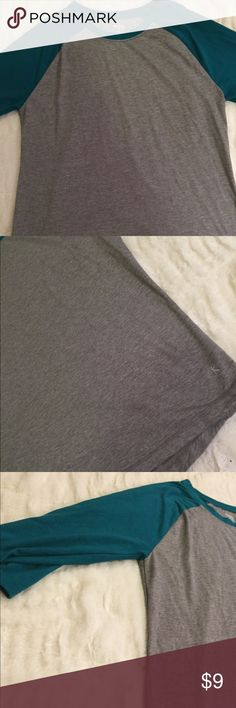 Like New Danskin Baseball Style Tee Size Large This Like New Danskin Baseball Style Tee Size Large is blue and gray. There are absolutely no signs of wear, marks, stains, or signs of use. It is a 3/4 Sleeve. Danskin Now Tops Tees - Short Sleeve