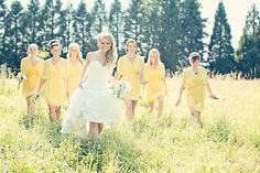 A beautiful bride and her stunning bridesmaids in pale yellow dresses from Anthem Photography