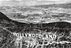 """Hollywoodland sign in the mid 1920's  The sign was first erected in 1923 and originally read """"HOLLYWOODLAND"""". Its purpose was to advertise the name of a new housing development in the hills above theHollywooddistrict of Los Angeles. The Crescent Sign Company was contracted to erect thirteen letters on the hillside, each facing south. The sign company owner, Thomas Fisk Goff designed the sign. Each letter of the sign was 30feet wide and 50feet high, and was studded with some 4,000 light…"""