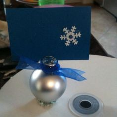 """Place Card Holder: ornament with nickel glued on bottom. Floral wire used to create the """"card holder"""" on top of ornament"""