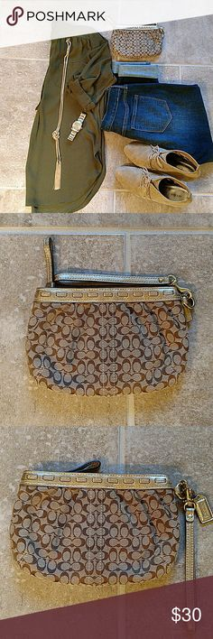 COACH wristlet Super cute wristlet by Coach. It's the perfect accessory for most any outfit and can be dressed up or down. A few small stains on inside of bag as shown in the photo 4, but they're not noticeable to anyone else. Smoke free, pet free home. Reasonable offers welcome! Coach Bags Clutches & Wristlets