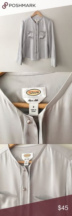 Talbots Silver Silk Blouse Stunning pearl tone button down silver silk blouse by Talbots. Neck ties can hang Long or be tied in a loose bow. Pearl tone buttons on cuffs. Two open breast pockets. Size 8. Like new. Talbots Tops Blouses