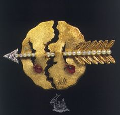 Dalí i Domènech, Salvador The world bloodied  Date 1953 Dimensions 5.50 x 7.20 x 1.80 cm Ubication Dalí · Jewels Technique:  Yellow Gold 18 Kt (750 mils); 18 Kt white gold (750 mils); Diamonds (6), brilliant cut (round), 1.5 to 2.5 mm in diameter, approximately; Natural ruby (corundum) (2), irregular fragments (teardrop) Pearls (17), 3.0 to 3.5 mm diameter