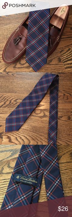 Navy plaid Brooks Brothers tie This sharp tie from Brooks Brothers has a navy background with a large white, blue, orange & red plaid.  Pair it with a blue or white shirt for instant style at work or on the go.  This tie is in excellent condition - had I not seen my husband wear I would never know it was pre-worn. Brooks Brothers Accessories Ties