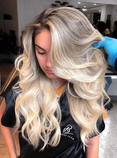 Beautiful ideas of bold and bright blonde curls for women to create in 2018. There are a lot of fun and enjoyment in long blonde curls. See here if you're looking for best ideas of blonde hair colors and highlights to make yourself more elegant and cute in the whole crown. Just follow these highlights for unique looks.
