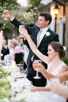 Bride and groom toasting at their outdoor wedding reception. Piedmont Driving Club Atlanta.