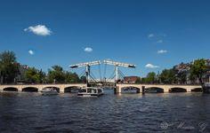 #Amsterdam #River Amstel #Magere brug #Skinny bridge #Netherlands #River #clouds #water #Boats #Architecture #Bridge Marina Bay Sands, Netherlands, Amsterdam, Boats, Bridge, Clouds, River, Skinny, Architecture
