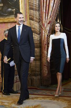 Queen Letizia chose a fitted knee-length dress with a colour-block pattern and stud detail to host the guests at the Royal Palace in Madrid, along with her husband, King Felipe VI of Spain.