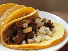 Quick Tacos Braised Beef Leftovers (Shredded beef, pork or chicken, cilantro, onions, queso fresco or feta cheese and tortillas)