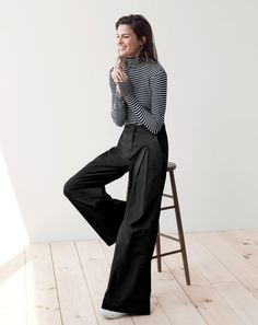 J.Crew women's tissue turtleneck T-shirt in stripe, ultra wide-leg chino pant in black and Tretorn® canvas sneakers in ivory.