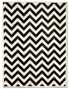 Exclusive Yves Cowhide Rug - Black by Pure Rugs: A modern adaptation on the classic herringbone pattern derived from bespoke suit design, the Yves rug is perfect for defining any space. The pieces of cowhide are individually selected and painstakingly hand-stitched together with a high resistant cotton ribbon then finished with a perfect zig-zag stitching detail. Casual, yet sophisticated.