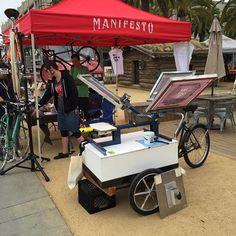Oakland's Team Print Shop at the Manifesto Bikes tent #screenprint #screenprinting #tees #bikes #print